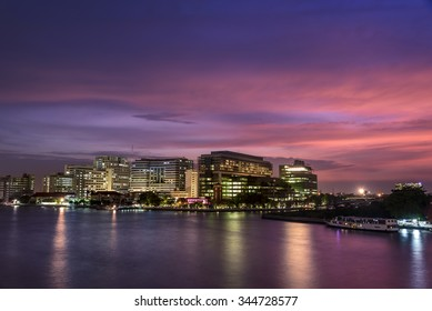 Sunset in river painting beautiful light in chao phraya river with sirirach hospital one of important bangkok landmark of thailand