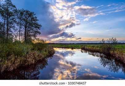 Sunset river stream reflection sky clouds landscape