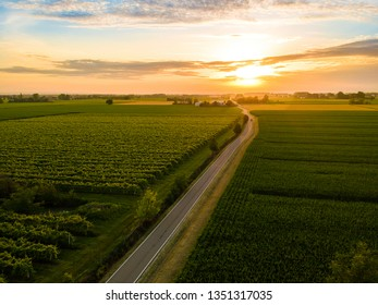Sunset road to the drone. Flat land