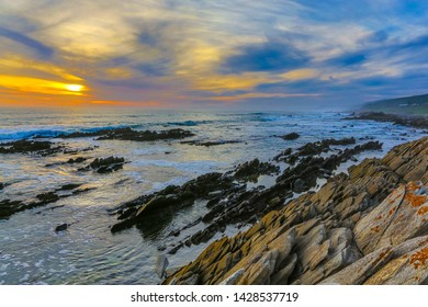 Sunset and rocks at the coast in South Africa