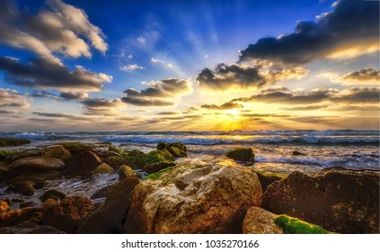 Sunset rocky beach landscape sky clouds