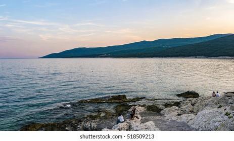 sunset at the rocky beach of Rabac Istria Croatia September 2016
