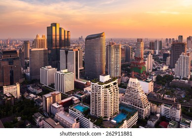 sunset rooftop view bangkok city office buildings tower, hotel and living, condominium in bangkok city  skyline top view Downtown and business office bank financial in capital city of thailand asian