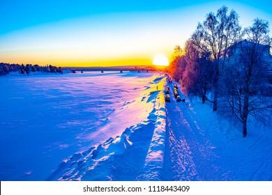 Sunset in Rovaniemi, Lapland, Finland, Kemijoki River in January