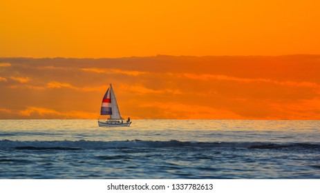 Sunset with sailboat near horizon