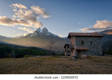 Sunset in Saldes, a small village from Berguedà (Barcelona). Behind a nice stone house, we can see Pedraforca, one of the most well-known mountains of Catalonia.