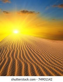 sunset in a sand desert