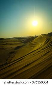 Sunset with sand dunes in desert