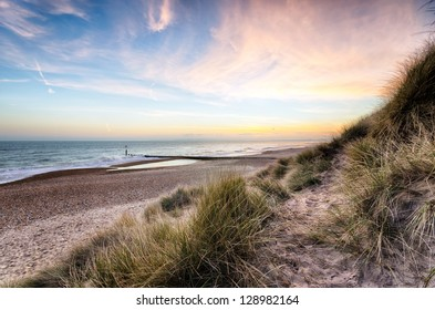 Sunset and sand dunes at Hengistbury Head beach near Bournemouth in Dorset