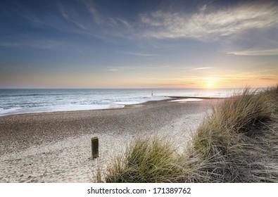 Sunset in the sand dunes at Hengistbury Head near Bournemouth in Dorset