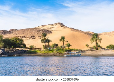Sunset, Sand dunes on the Coastline of the Nile river part called First Cataract, Aswan, Egypt
