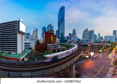 Sunset scence of modern office buildings and condominium in Bangkok city downtown with blue sky and clouds at Bangkok , Thailand. And skytrain