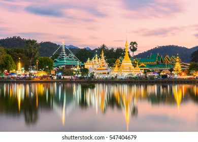 Sunset scence of Wat Jongklang temple - Wat Jongkham temple the most favourite place for tourist in Mae hong son near Chiang mai, Thailand with reflect sky in water