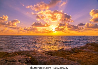 Sunset scene with cloudscape over the horizon of the Mediterranean coast of Haifa, Israel