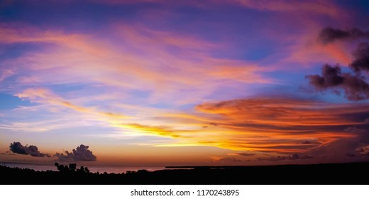 Sunset scene colourful clouds and sky dusk time in Tobago sea on the far away horizon