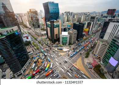 Sunset scene of light trails traffic speeds through an intersection in Gangnam center business district of Seoul at Seoul city, South Korea.