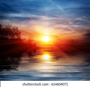 Sunset scene over lake water surface