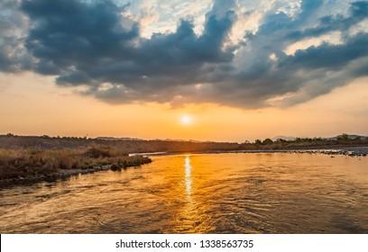 Sunset scene over Ramganga River, in Dhikala, Jim Corbett National Park, India