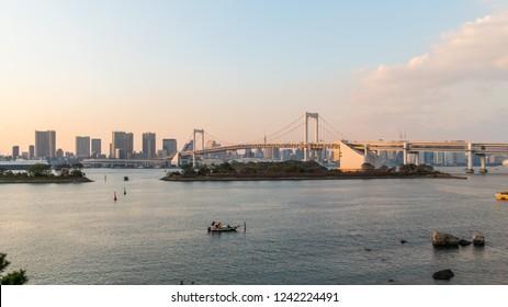 Sunset scene of Rainbow bridge and tokyo skyline at Odaiba, Tokyo, Japan