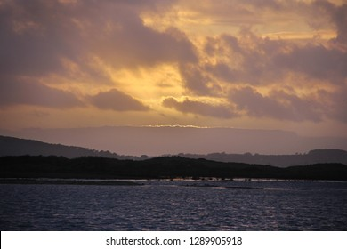 sunset scene with sea and land, the Crozon peninsula in France
