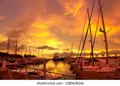 sunset scene with yatch docking point at kota kinabalu, borneo