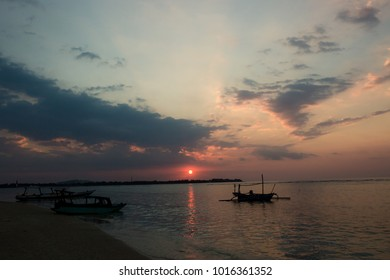 Sunset scenery with a boat in Gili Air