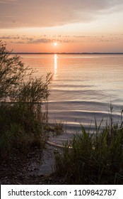sunset scenery at lake shore chiemsee in summer, upper bavaria