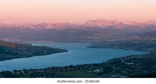 sunset scenery of lake zuerich at sunset on a clear day, view from uetliberg, switzerland