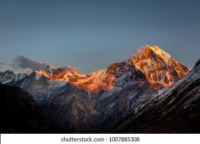 Sunset scenic of Machapuchare mountain view point during Annapurna base camp  trekking route, Nepal . The Annapurna Sanctuary is a high glacial basin lying 40 km directly north of Pokhara.