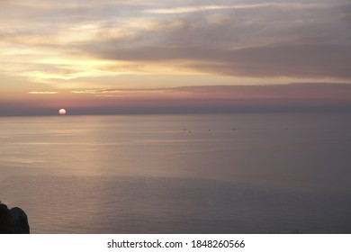 Sunset in the sea with clouds