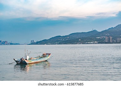 Sunset at sea with evening sunlight with boat at Tamsui / Taiwan / New Taipei