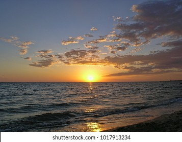 Sunset at the Sea. Follonica, Grosseto, Tuscany, Italy. Small Clouds
