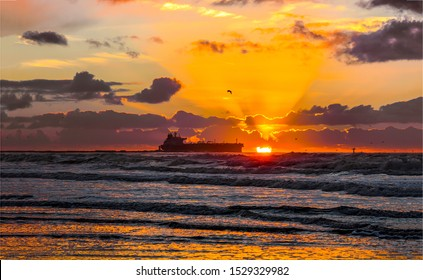 Sunset sea horizon cargo ship silhouette landscape. Cargo ship sunset horizon sea view. Sea sunset cargo ship landscape. Sunset sea cargo ship silhouette view