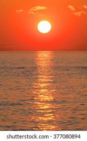 Sunset at sea ocean in beautiful winter season