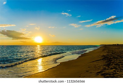 Sunset sea sand beach landscape. Sea sand beach sunset panorama. Sunset sand beach view