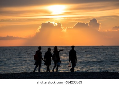 Sunset in the sea, sundown, black sea, lifestyle, resort, life and power concept, Silhouette group of people on the beach at golden sunset time, Hello summer concept