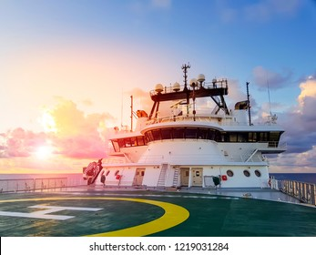 sunset at sea with view of modern offshore rov / construciton support vessel