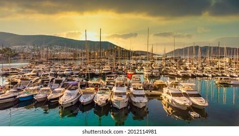 Sunset sea yachts in yacht port Bodrum. Yachting sunset scene. Sunset yachts view. Yachts in sunset bay. Yalikavak Bodrum Marina, sailing boats and yachts in Bodrum