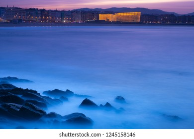 Sunset in the sea with Zurriola beach in the city of San Sebastian, Basque Country