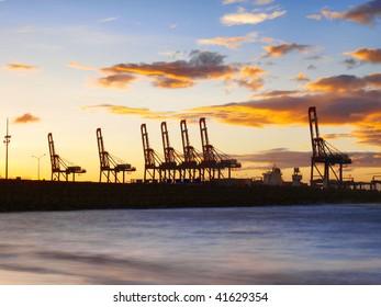 Sunset in seacoast near cargo wharf