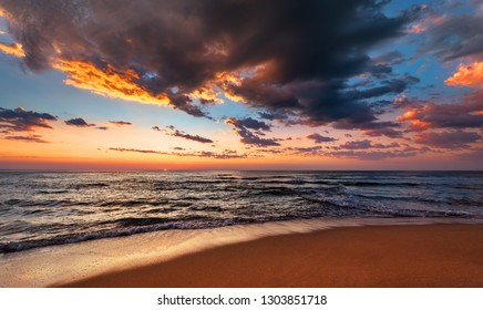 Sunset seascape with dramatic sky and colorful clouds.