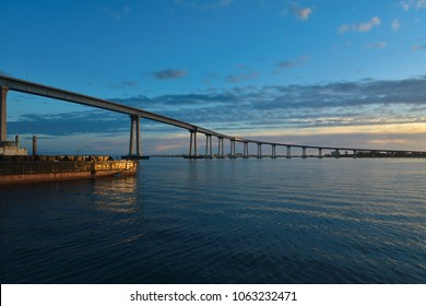 Sunset seascape with panoramic view of Coronado Bridge as seen from Cesar Chavez Park in San Diego, California.
