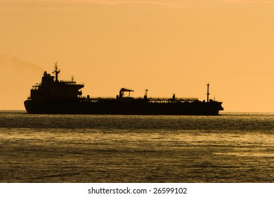 sunset at the seaside and cargo ship