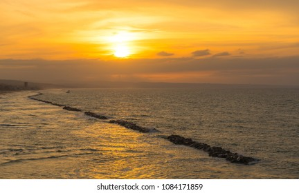 Sunset at the seaside at the east coast of Italy