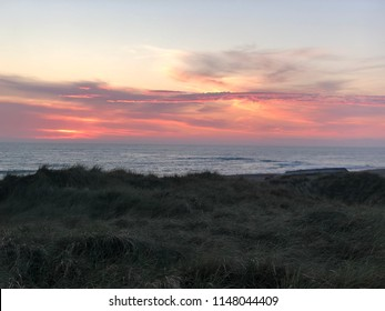 Sunset seen from the dunes at Klitmøller beach, northern Denmark. Also known as Cold Hawaii.