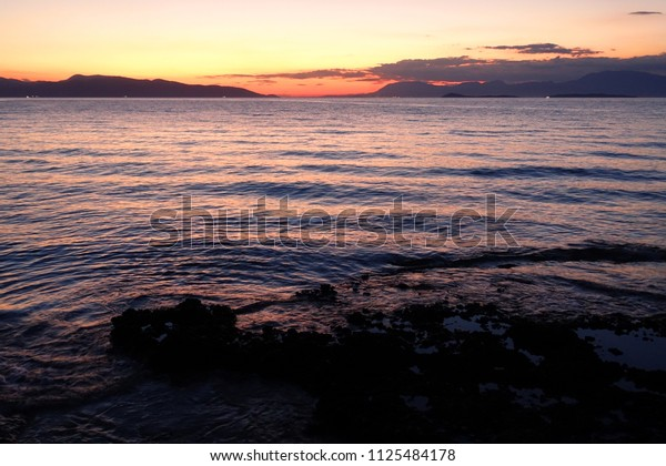 Sunset as seen from village of Megalochori, Agistri island, Saronic gulf, Greece