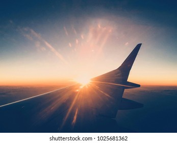 Sunset as seen from window plane, Photo from smartphone, vintage tone