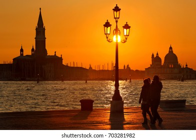 Sunset in Sestiere di Castello, Venice, Italy. The silhouettes in the background belong to Chiesa di San Giorgio Maggiore (left) and Basilica di Santa Maria della Salute (right). Date taken:17.3.2016