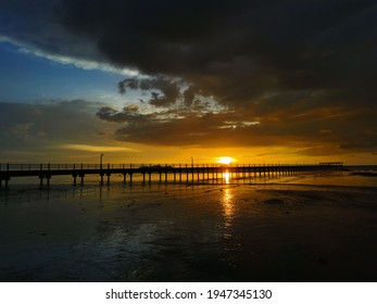Sunset shaded by a pier. This picture was taken at Murni Beach, Malaysia