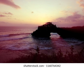 Sunset Shine the sun has begun to set at Batu Bolong Temple, Tanah Lot, Bali, Indonesia